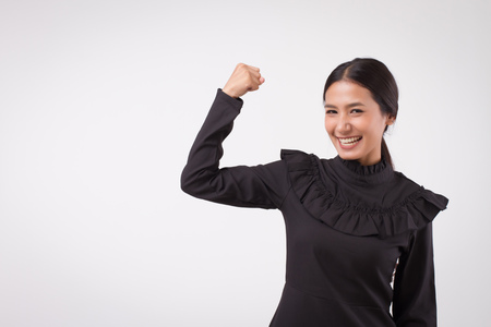 Foto de happy smiling excited woman portrait looking; surprised laughing happy woman, smiling girl looking studio isolated; woman looks up, smiles with happy joyful cheerful face expression; asian woman model - Imagen libre de derechos