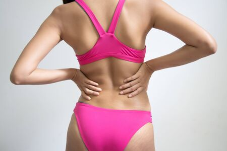 woman sufferring from back pain at lumber spine or spinal herniated disc