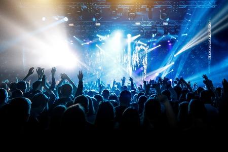 Photo pour A lot of hands, crowd on concert, blue light - image libre de droit