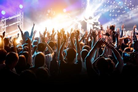 Photo pour Crowd with raised hands on music concert. - image libre de droit