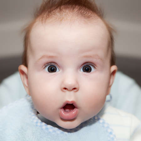 Cute 4 months old baby making a funny surprised face