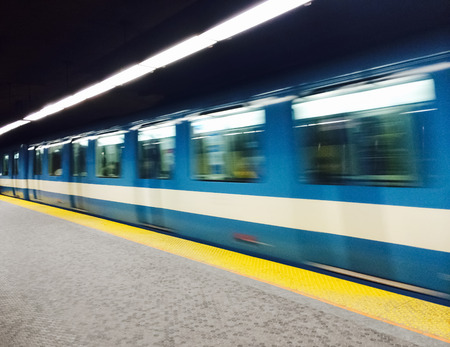 Montreal subway station and train with motion blur