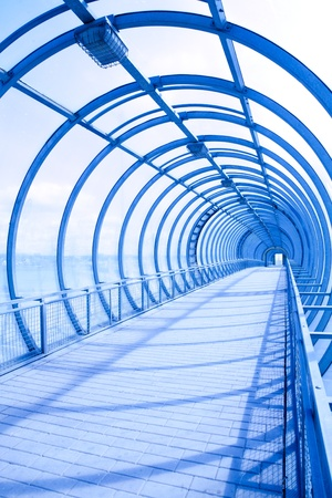 empty blue glass tunnel for elevated transit