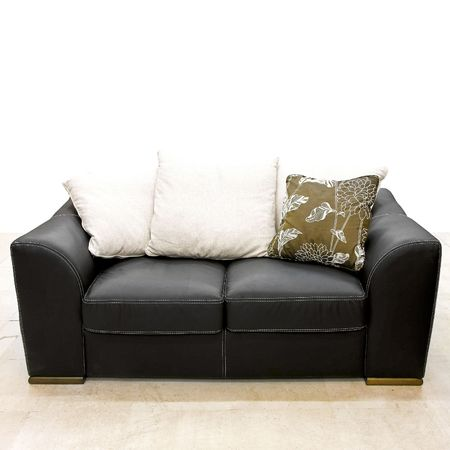 Close up shot of black leather couch