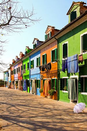 Small Burano island street with colorful buildings