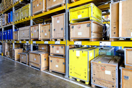Rugged crates at shelves in museum warehouse