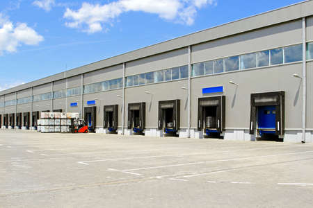 Cargo doors at big industrial warehouse building