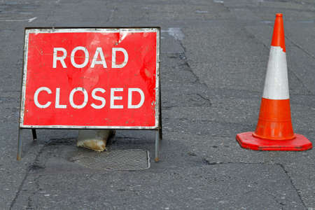 Sign on a street closed for road reconstruction