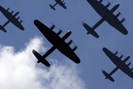 A massed formation of British Lancaster bombers flying overhead.