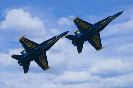 Two F-A18 Hornets from the US Navy Blue Angels Flight Demonstration Squadron flying in forma
