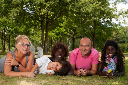 Happy multicultural family having a nice summer day