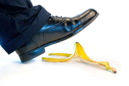 Someone about to slip and fall on a banana