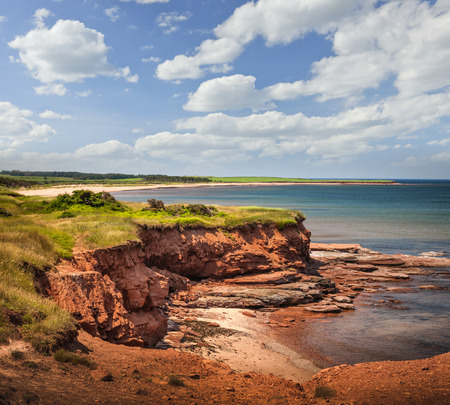 Red cliffs of Prince Edward Island Atlantic coast at East Point PEI Canada.