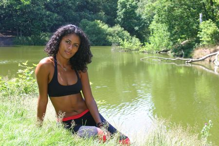Beautiful brazilian woman near the lake