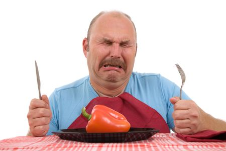 Overweight man looking very unhappy with his diet and bursting into tears