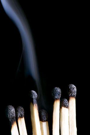 object on black - match with smoke