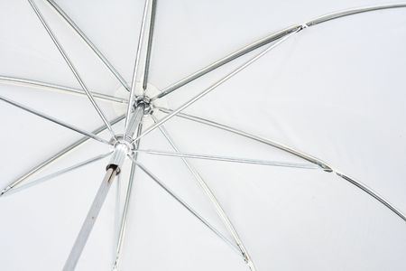 Inside view of white photo umbrella: ribs and tent