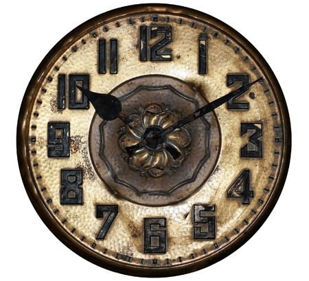 An antique clock shows ten past ten.