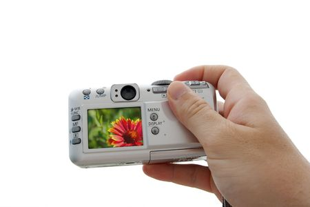 Digital camera in human hand isolated on white