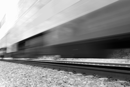 Train moving fast with motion blur. Black and white high-key imageの写真素材