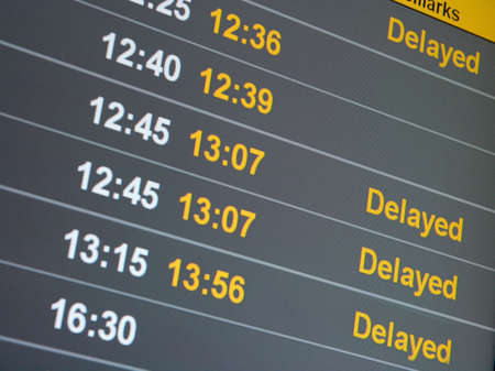 Many delayed flights on the departure table of an airport