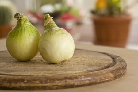 Vegetables lying on the tabla on window background