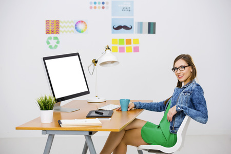 Woman Working At Desk In A Creative