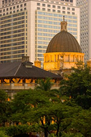 The old Hong Kong legislature building contrasting against the modern skyline in the evening sun