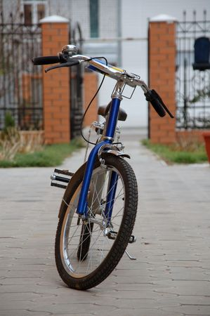 Child's bike near of the house