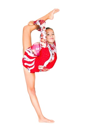 Beautiful Asian girl gymnast with a ball on white background