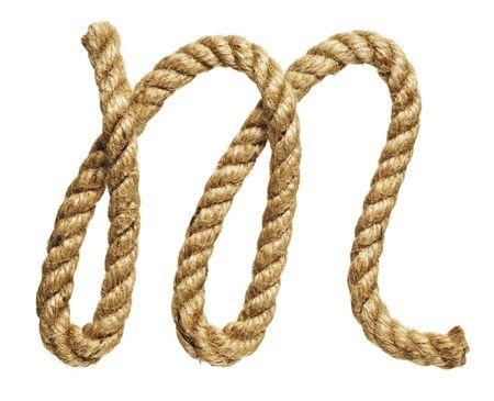 old natural fiber rope bent in the form of letter M