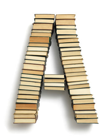 Letter A formed from the page ends of closed vintage hardcover books standing on a white background