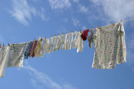 A laundry line in a crisp blue sky.