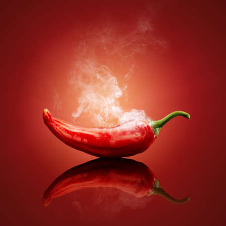 Hot chili red smoking or steaming with reflection
