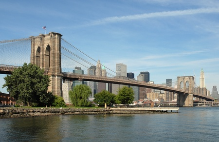 Picture of the iconic Brooklyn Bridge in New York City, taken from the Brooklyn shoreline looking across towards Manhattan