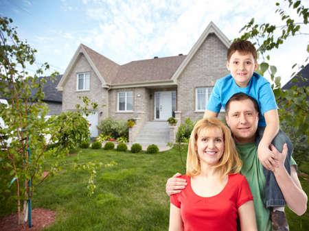 Happy family near new house