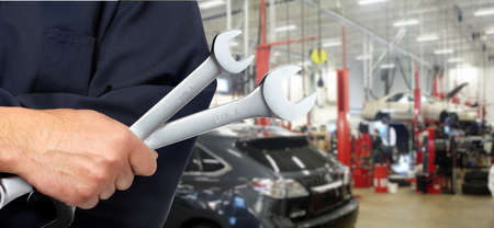 Hand with wrench  Auto mechanic