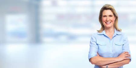Mature blonde business woman portrait. Accounting and finance.