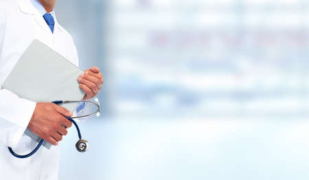 Hands of medical doctor with clipboard. Health care background.