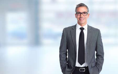 Handsome smiling businessman over blue banner background.