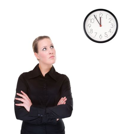 Full isolated portrait of a beautiful caucasian businesswoman locking at the clock