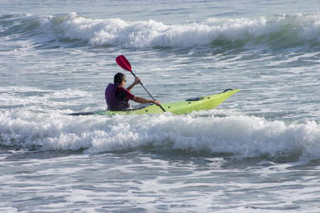 Several kayakers were out on this November day enjoying the wind and the sea waves in France.