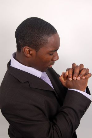 This is an image of a man on his knees praying