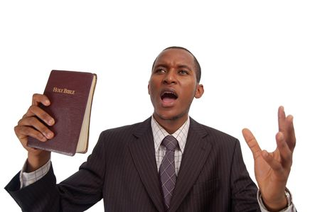 This is an image of man holding a bible. This image can be used to represent sermon, preaching etc...