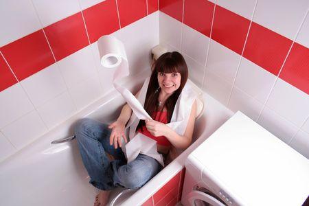 funny girl throwing toilet paper in bathroom