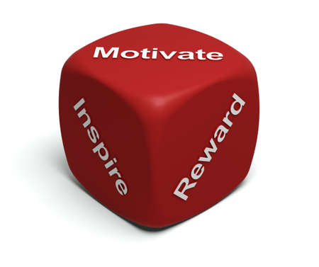 Red Dice with words Inspire, Motivate, Reward on faces