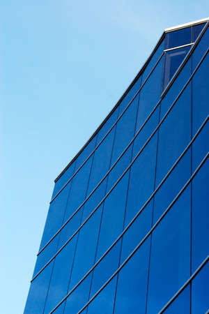 Feature of a modern glass coating of modern office buildings-strengthen blueness of the sky, thus making their elegant