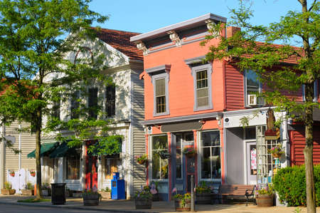 Quaint shops in bright morning sunlight on historic Main Street of Hudson, Ohio