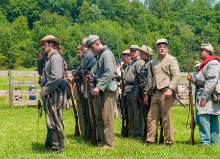 BATH, OH, USA - AUGUST 9, 2014  Confederate soldier reenactors line up to march into battle at a Civil War reenactment of the 3rd Battle of Winchester  1864  at Hale Farm and Village in Ohio