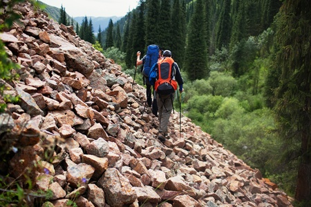 Two backpackers in wilderness mountains